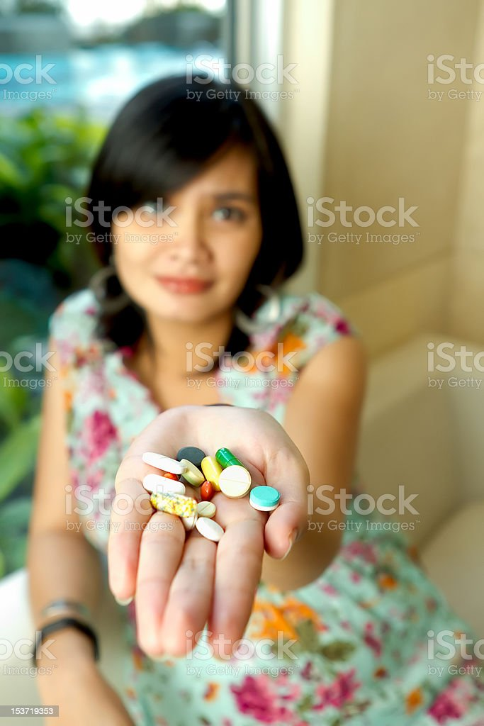 Asian Pregnant Woman and Medicine royalty-free stock photo