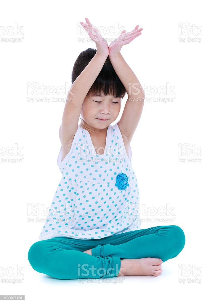 Asian pretty girl doing yoga exercises. Isolated on white backgr stock photo