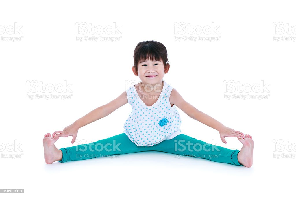 Asian pretty girl doing yoga exercises. Isolated on white background. stock photo