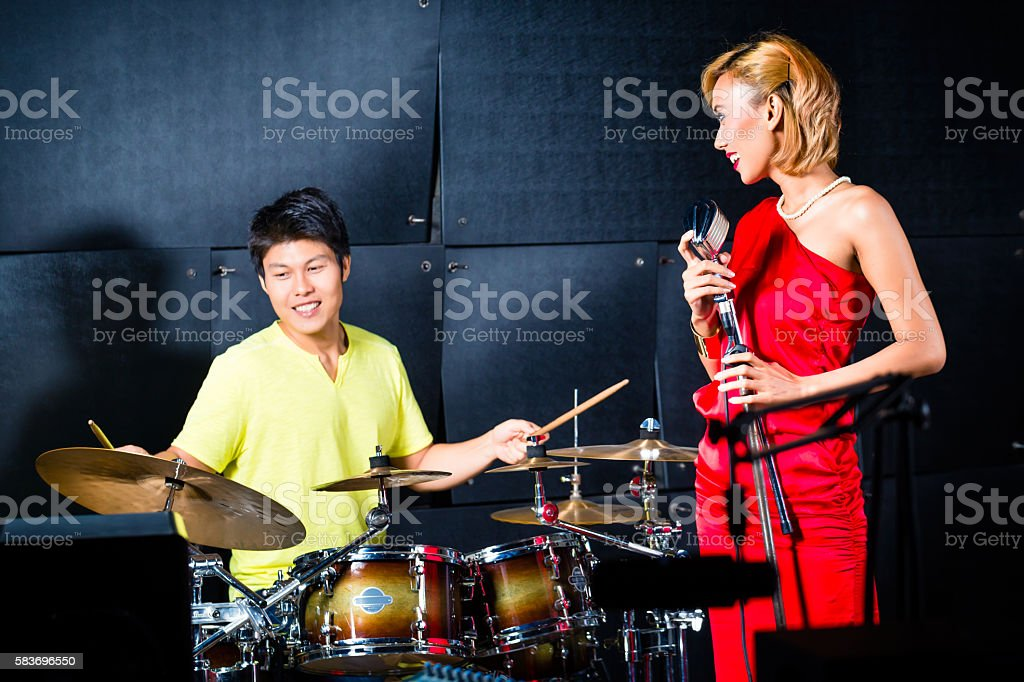 Asian professional band recording song in studio stock photo