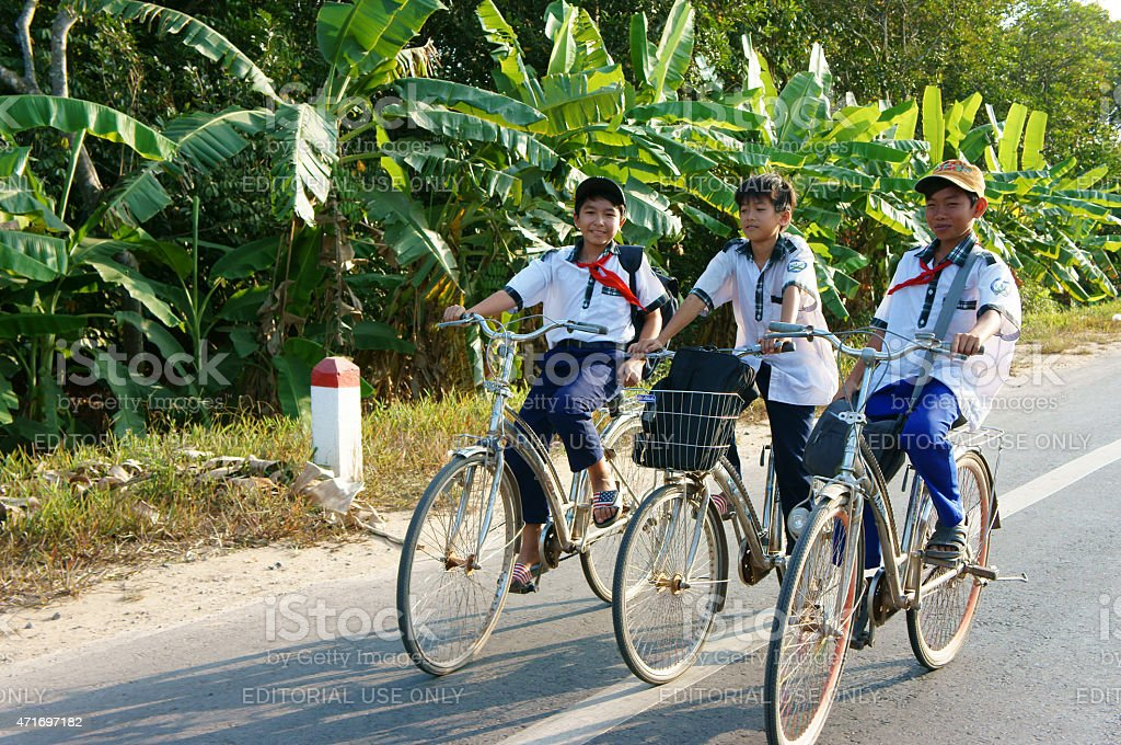 Asian pupil ride bicycle stock photo