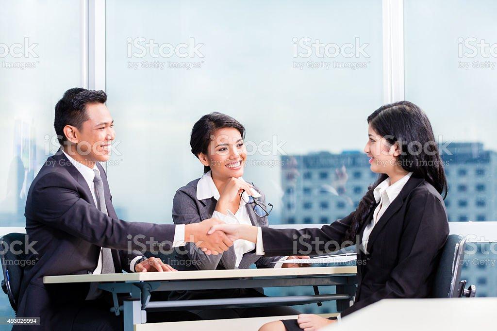 Asian recruitment team hiring candidate stock photo