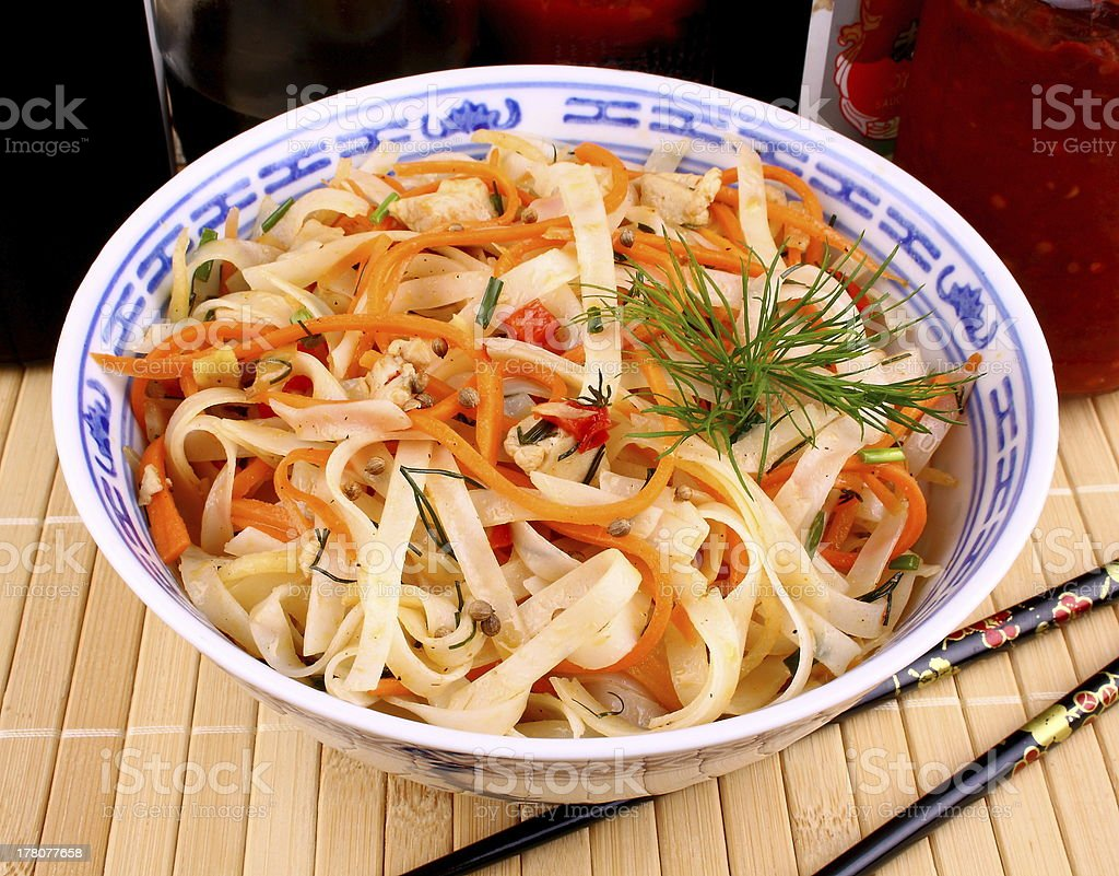 Asian rice noodle, chicken meat and sauce royalty-free stock photo
