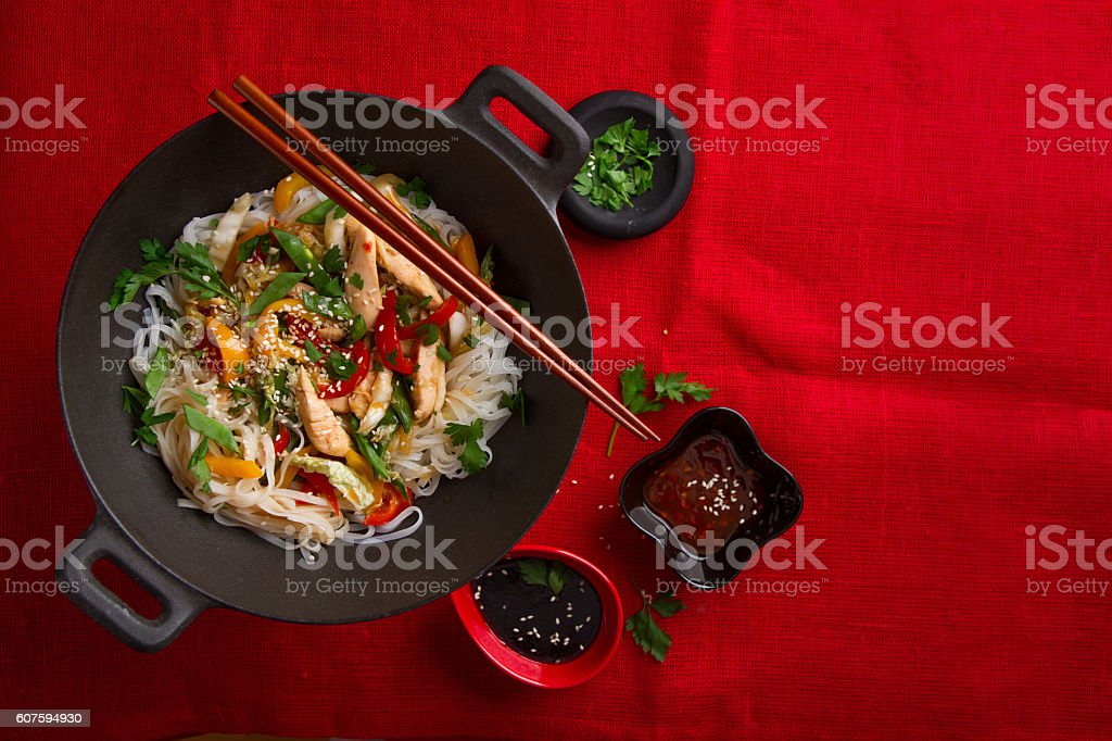 Asian rice noodles wok with chicken and vegetables stock photo