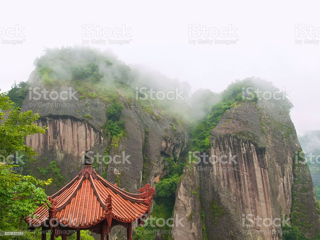 asian roof and mountains stock photo