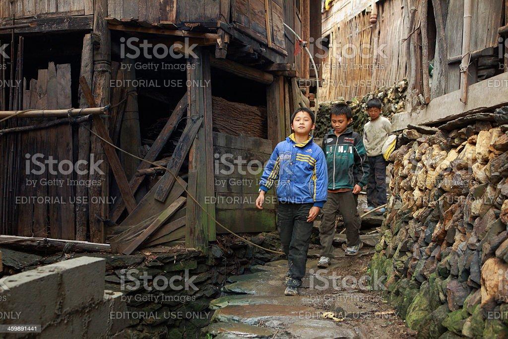 Asian rural, peasant, farmer, kids teens walk around Chinese village stock photo