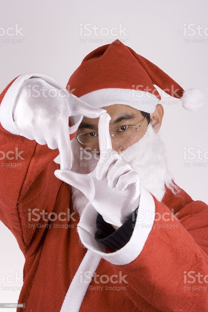 Asian Santa Claus With Framing Gesture royalty-free stock photo