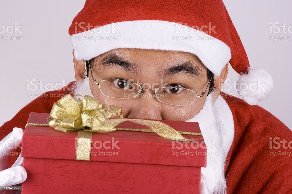 Asian Santa Claus With Present stock photo