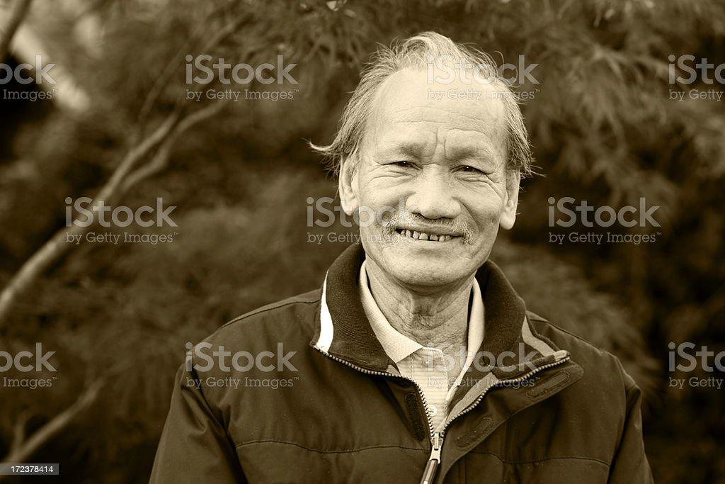 Asian Senior Adult Man Smiling in Sepia Tone Portrait, Copyspace royalty-free stock photo