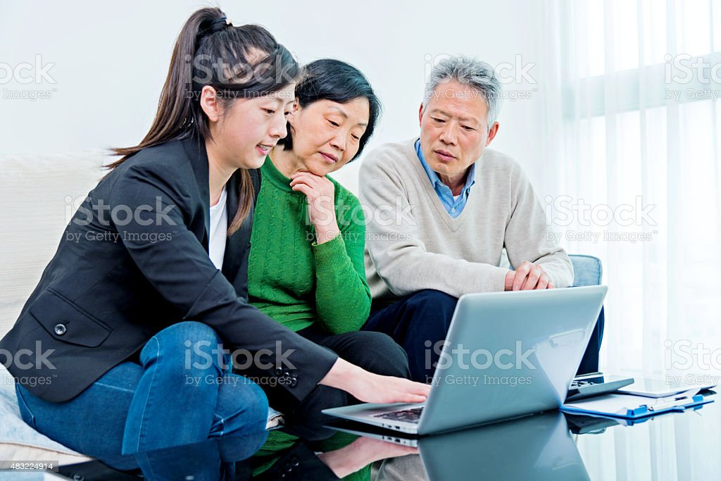 Asian senior couple meeting with financial planner stock photo