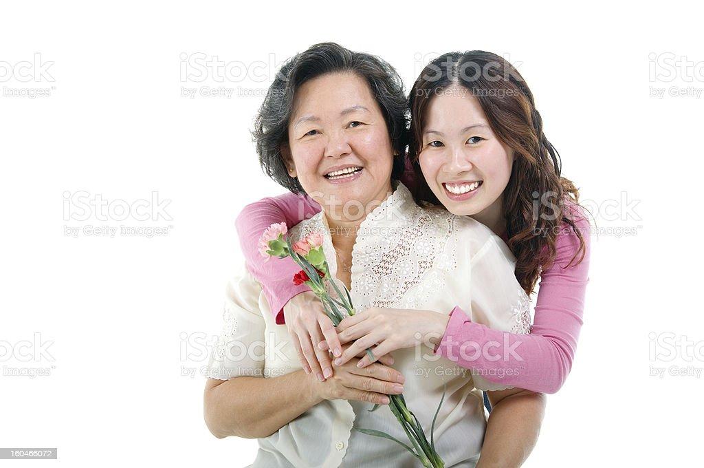 Asian senior woman and daughter royalty-free stock photo