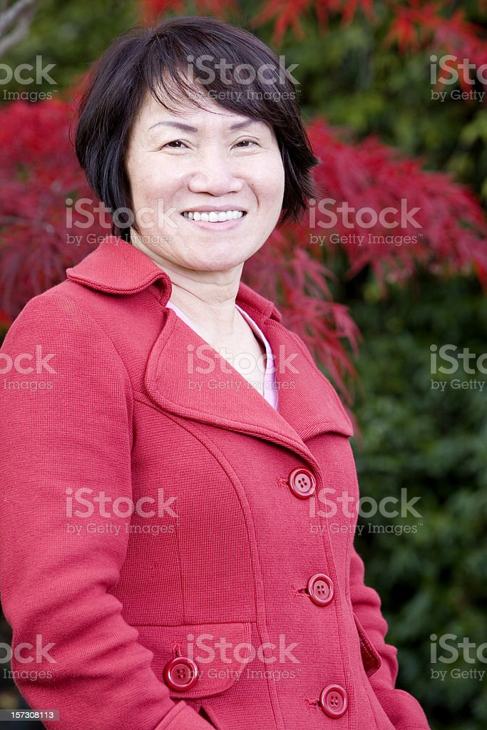 Asian Senior Woman Portrait Outside in Fall, Vertical stock photo