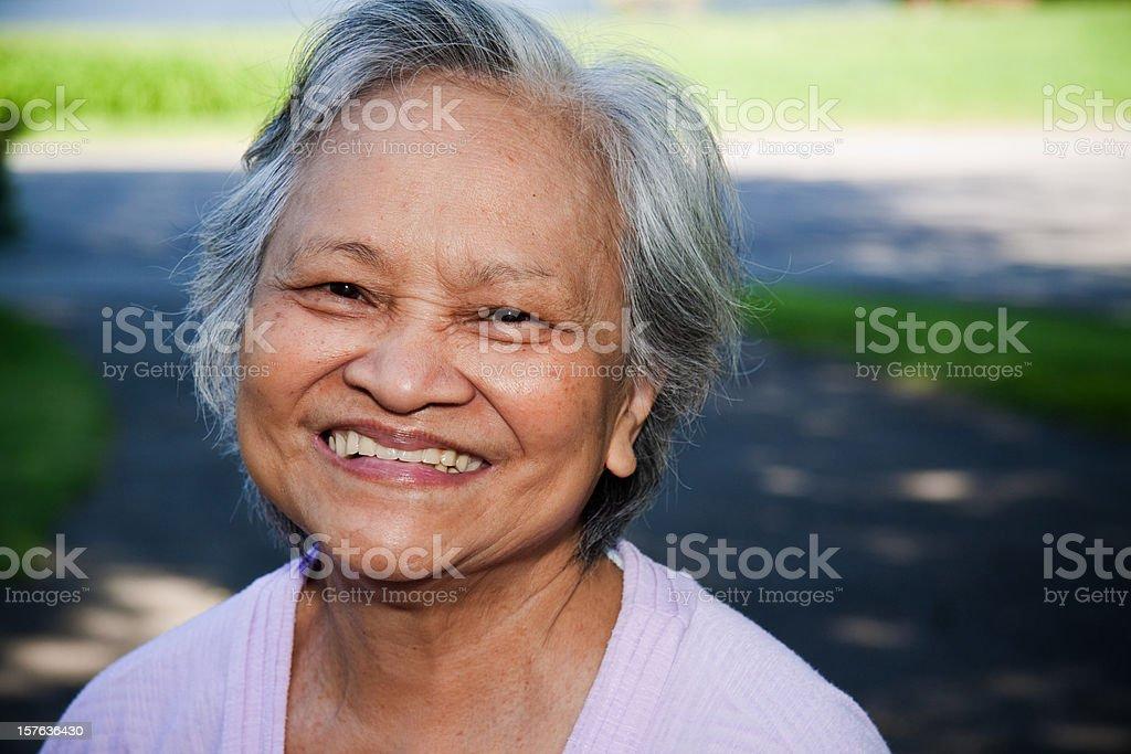 Asian senior woman smiling with white shirt stock photo