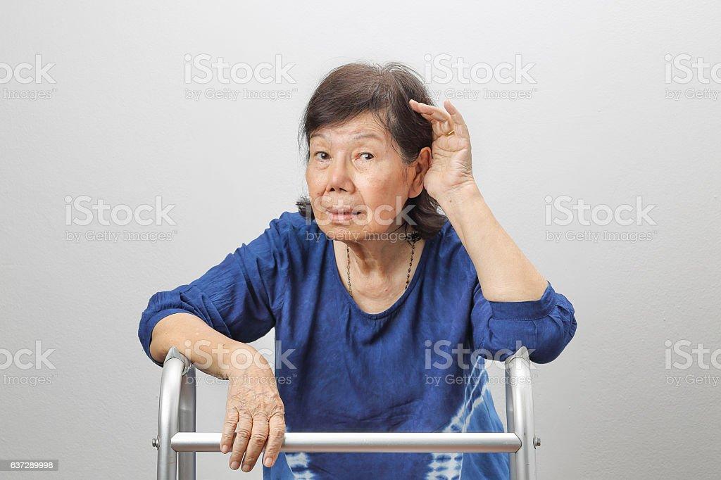 Asian seniors woman hearing loss , Hard of hearing stock photo