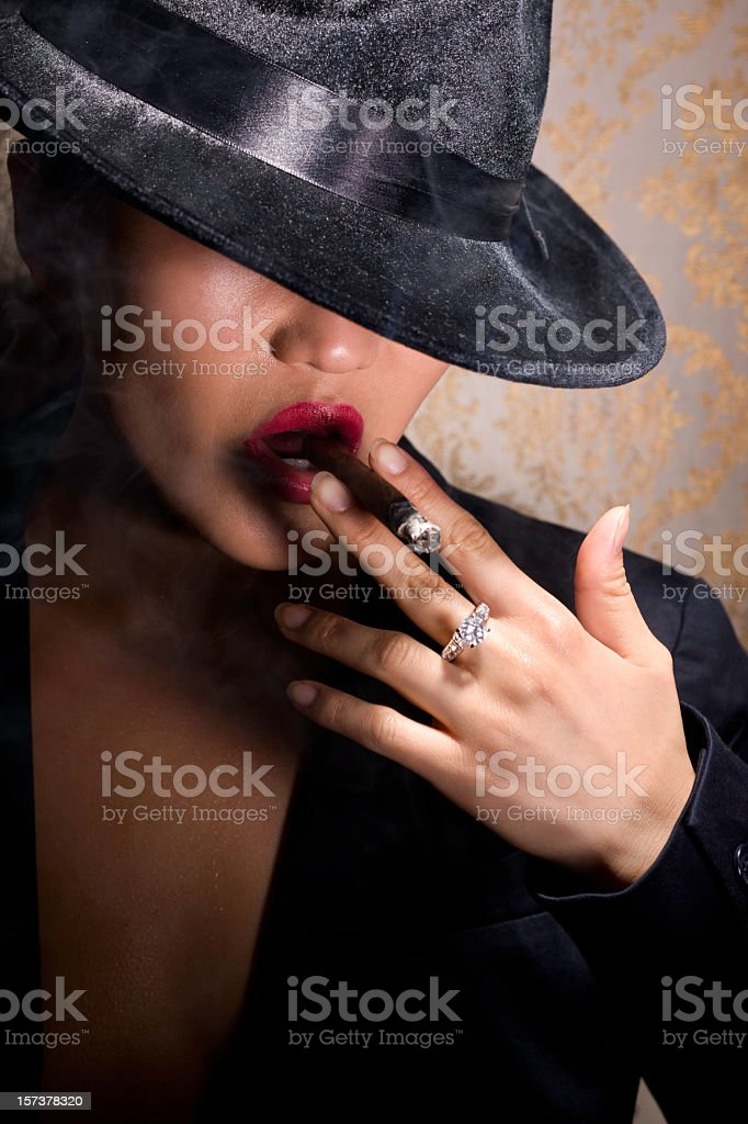 Asian Sexy Young Woman Portrait Smoking Cigar in 30s Fedora stock photo