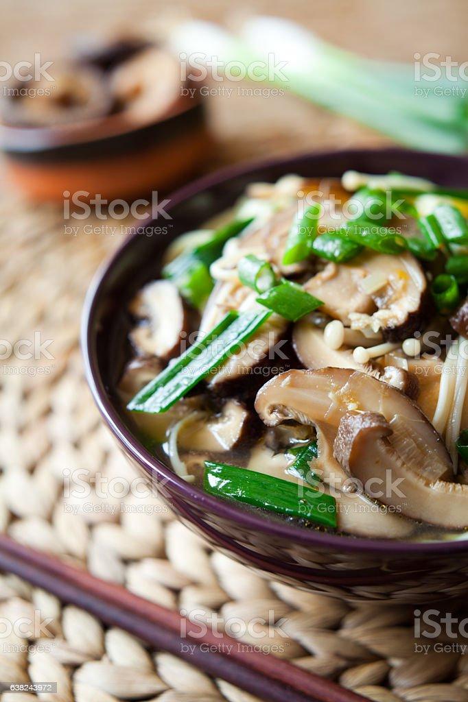 Asian Shiitake and Enoki Mushrooms Noodle soup. stock photo