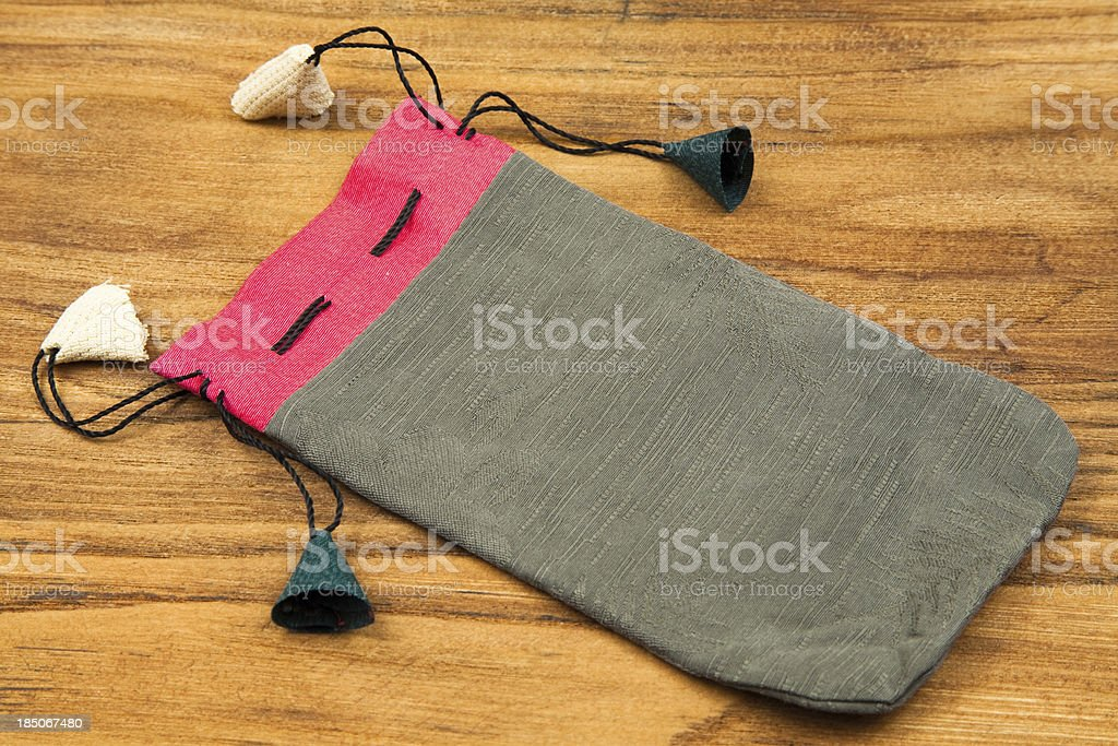 Asian silk bag or jewellery purse on old wood stock photo