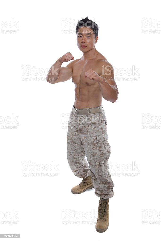 Asian Soldier in attacking pose royalty-free stock photo