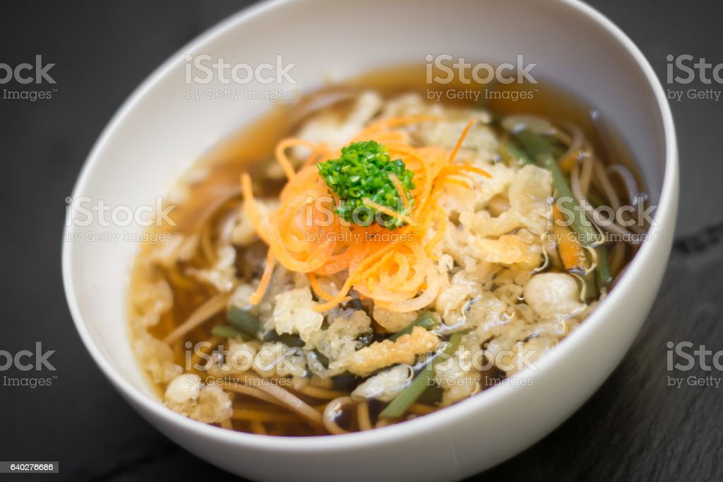 asian soup with soba noodles stock photo