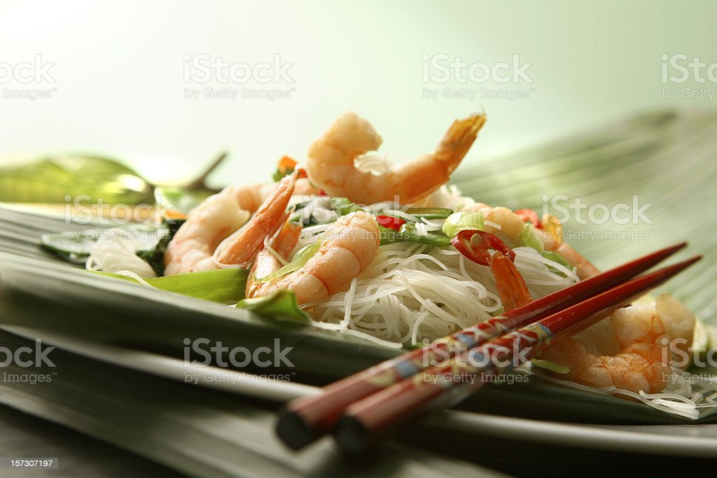 Asian Stills: Stir Fried Shrimps and Noodles on Banana Leaf royalty-free stock photo