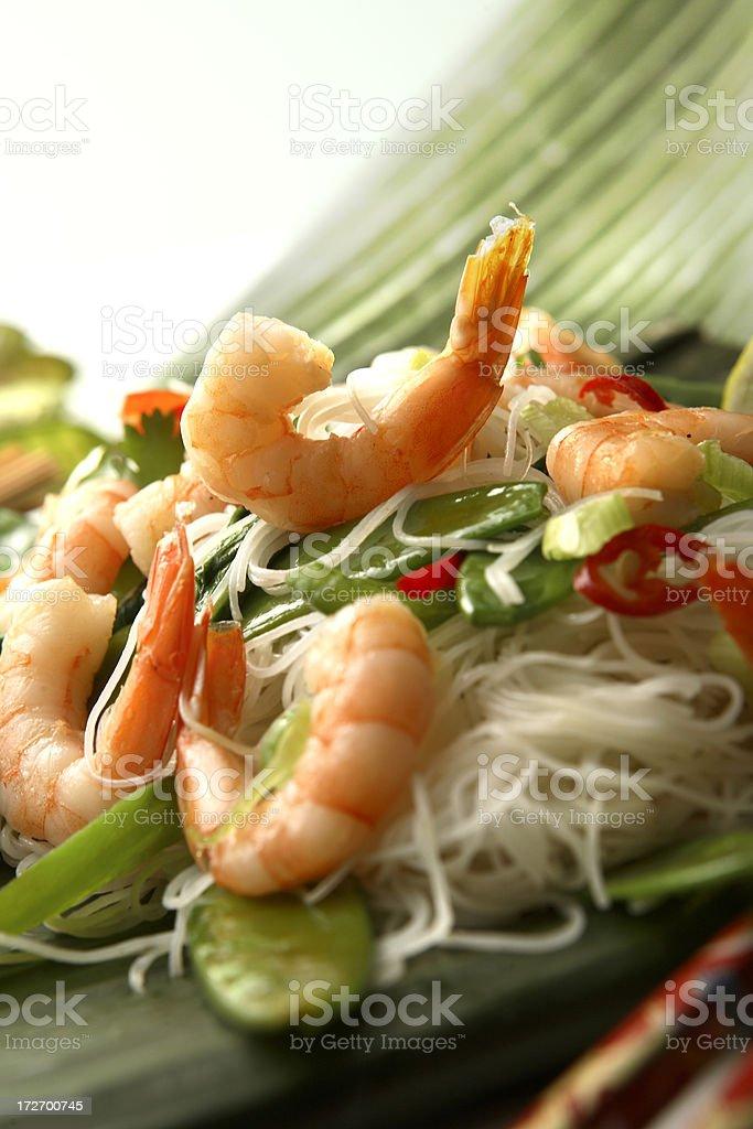 Asian Stills: Stir Fried Shrimps and Noodles on Banana Leaf royalty-free stock photo