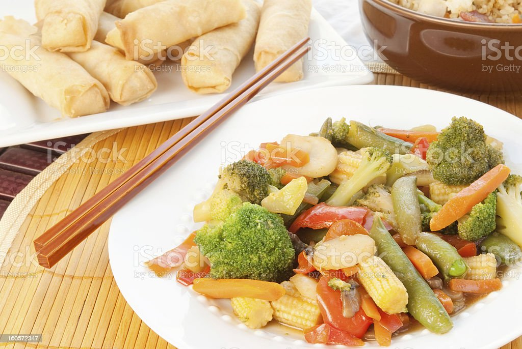 asian stir fry with assorted vegetables with shrimp spring rolls royalty-free stock photo