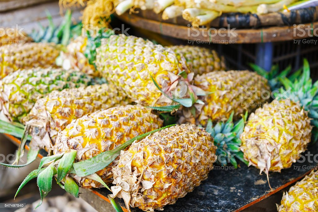 Asian street farmer market selling fresh ananas in Vietnam stock photo