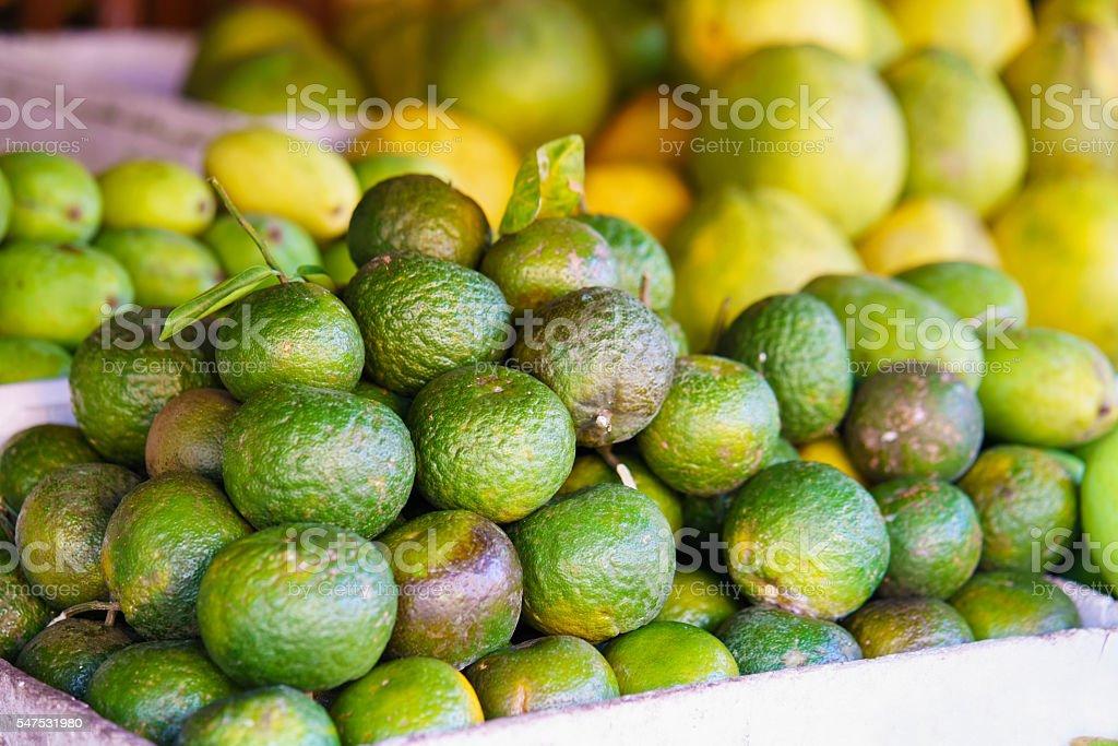 Asian street farmer market selling fresh green mandarin in Vietnam stock photo