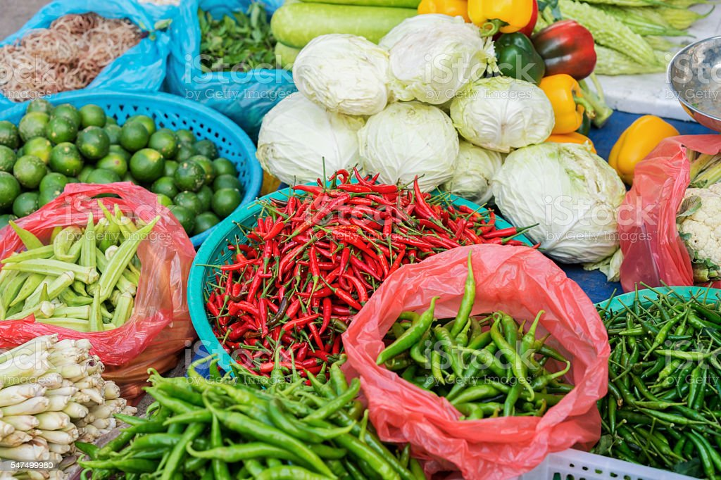 Asian street market selling Pod Pepper lime and cabbage stock photo