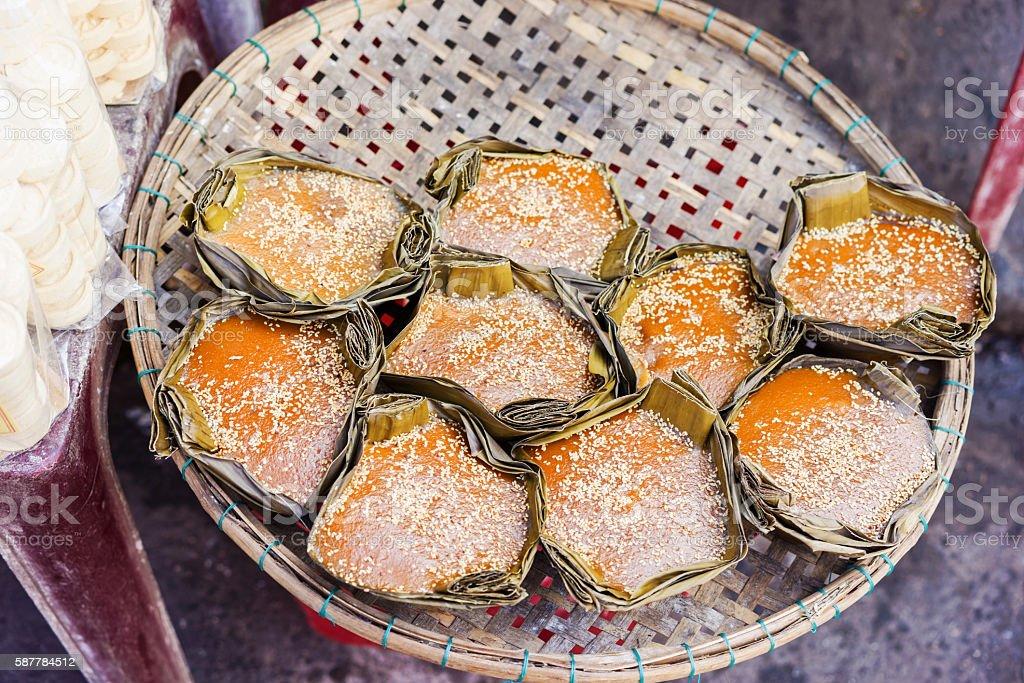 Asian street market selling sweet mango cake in Vietnam stock photo