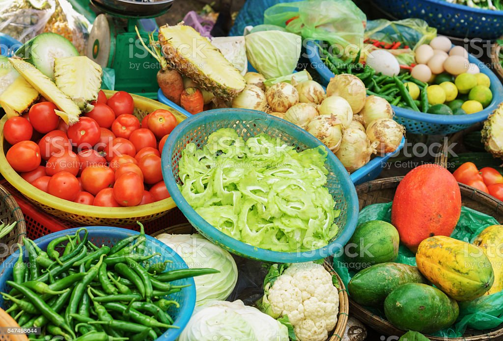 Asian street market selling tomato pepper cabbage and onion stock photo