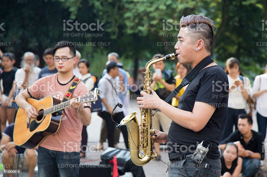 Asian street musician performing with their instruments stock photo