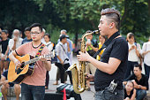 Asian street musician performing with their instruments