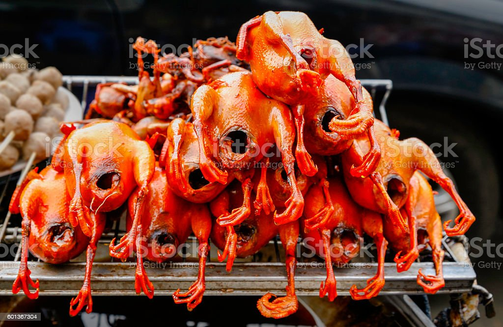 Asian street stall with barbecued red roast chicken stock photo