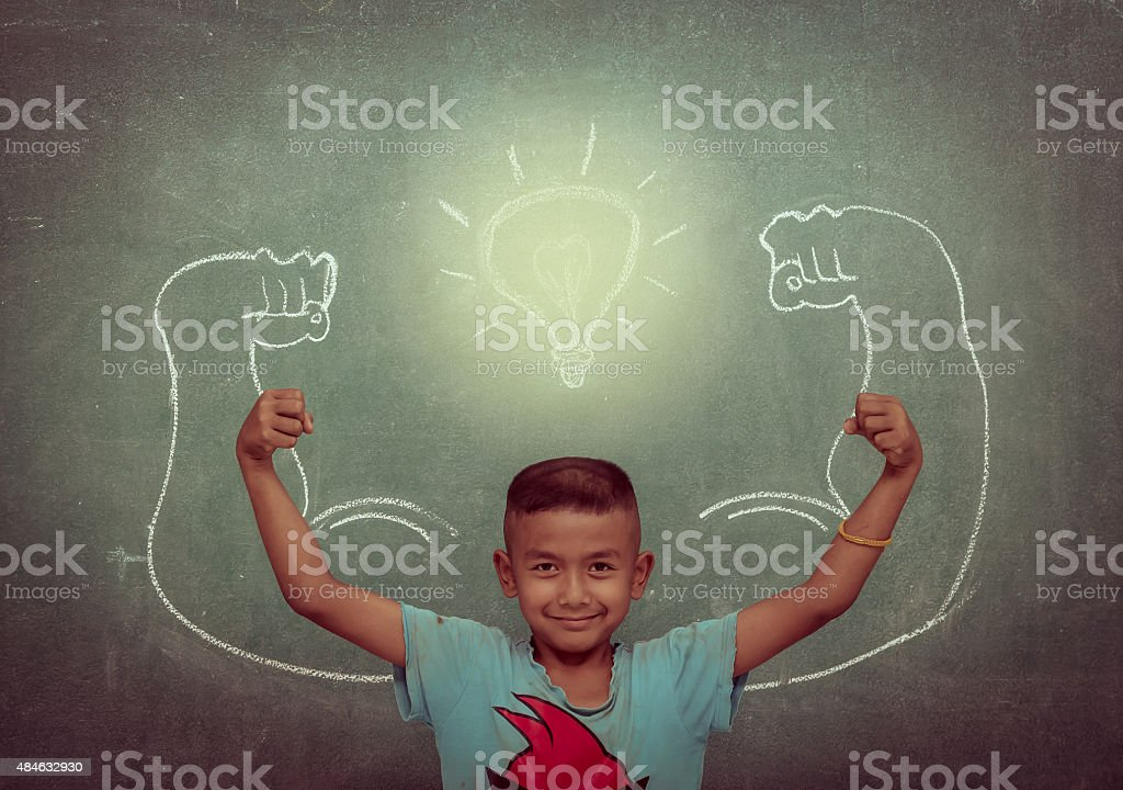 asian strong children against blackboard in classroom, Education stock photo