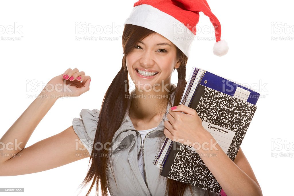 Asian student girl in Christmas Santa hat with composition book royalty-free stock photo