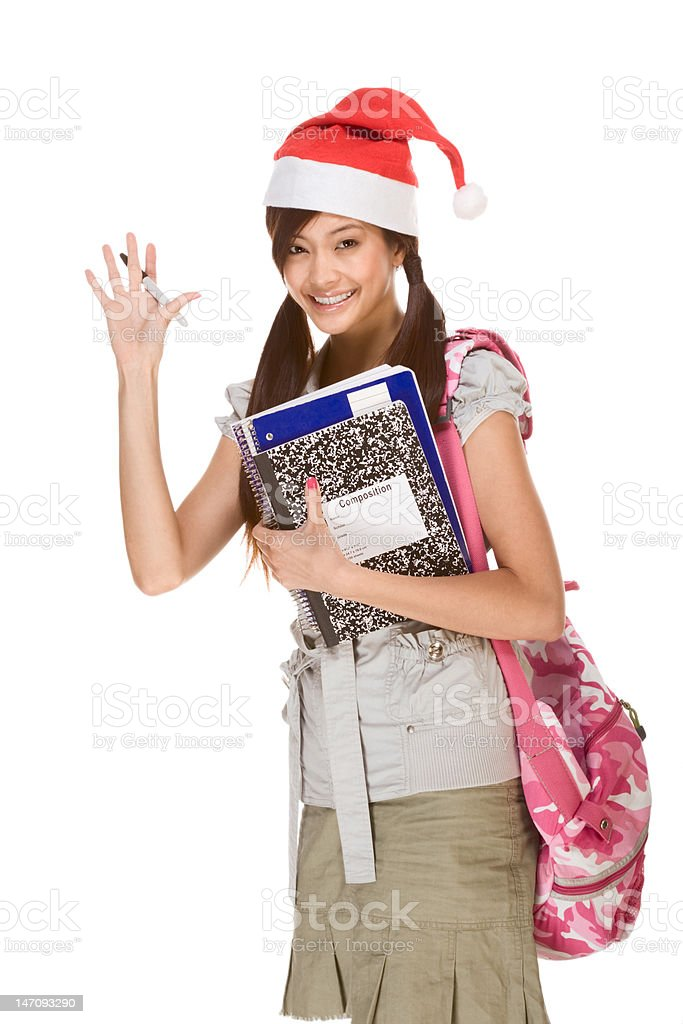 Asian student in Christmas hat gesturing greets royalty-free stock photo