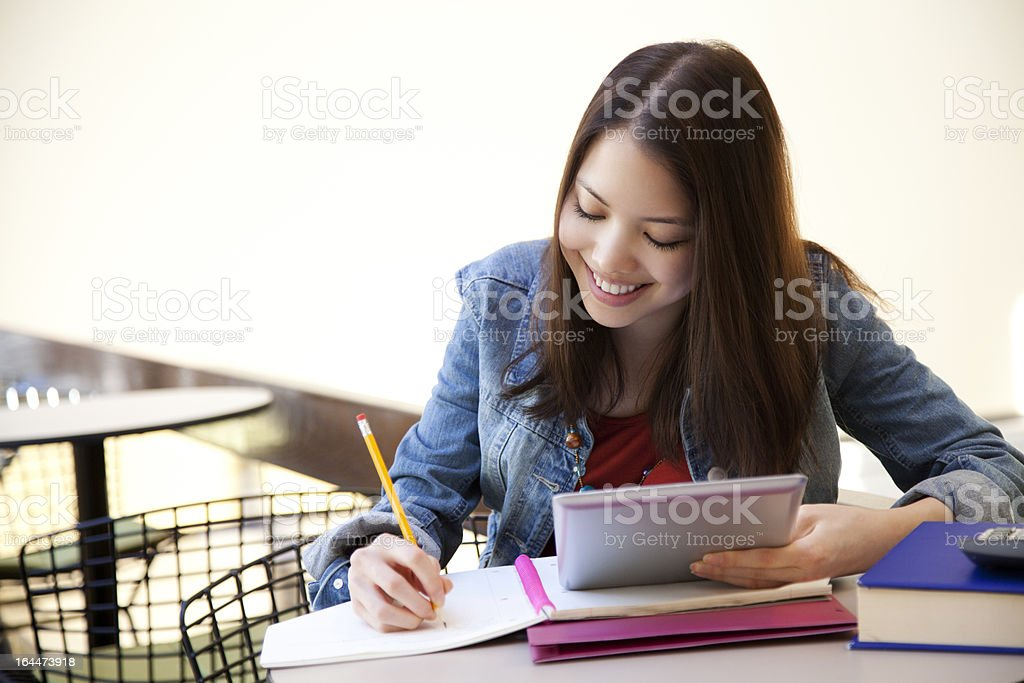 Asian student studying with digital tablet royalty-free stock photo