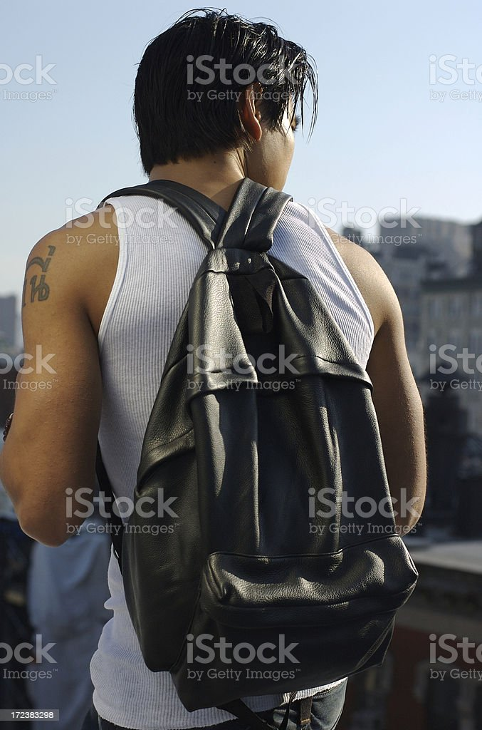 Asian Student with Backpack Standing Outdoors in Cityscape royalty-free stock photo