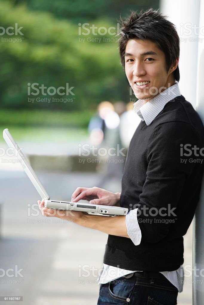 Asian student with laptop royalty-free stock photo