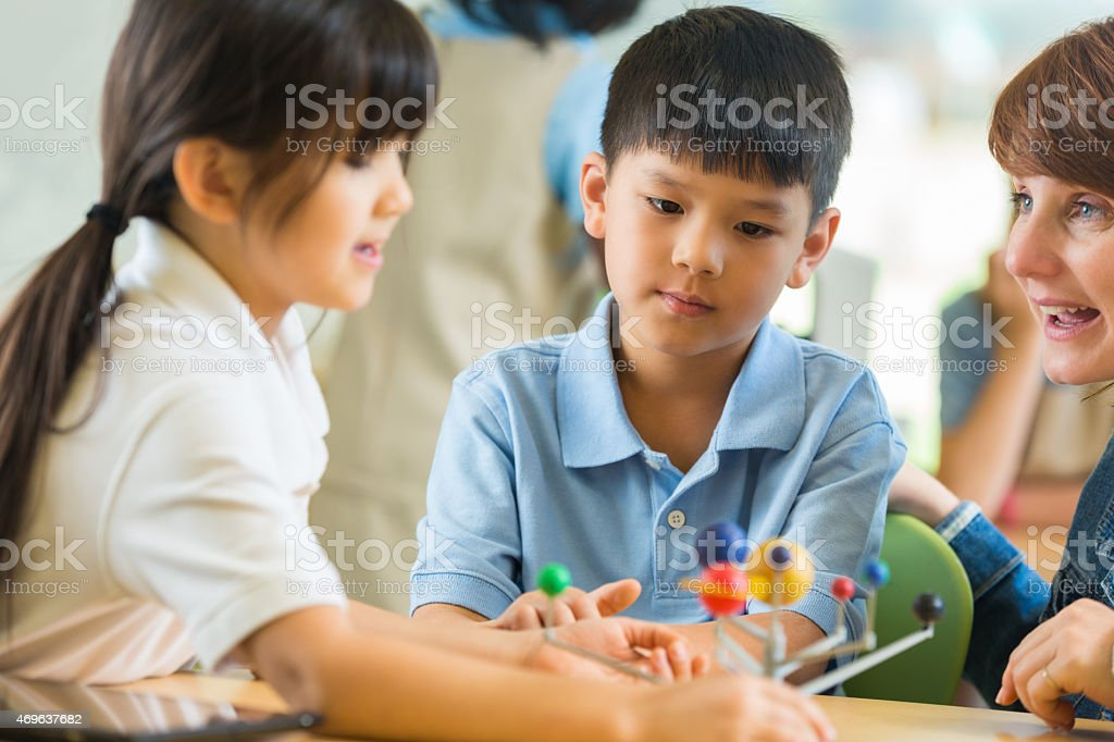 Asian students in private elementary school in science class stock photo
