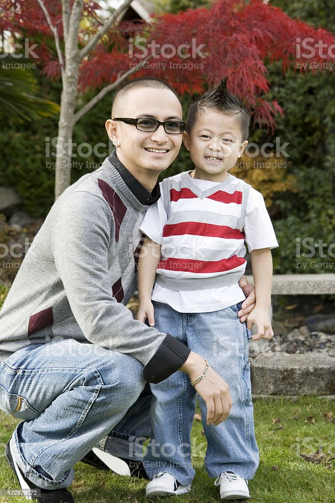 Asian Styish Young Man Father Posing with Son Outdoors royalty-free stock photo