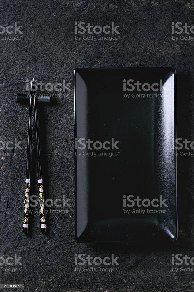 Asian tableware over black stock photo