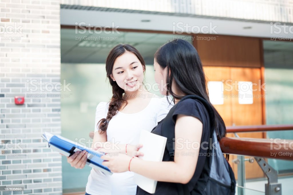 Asian teacher and student royalty-free stock photo