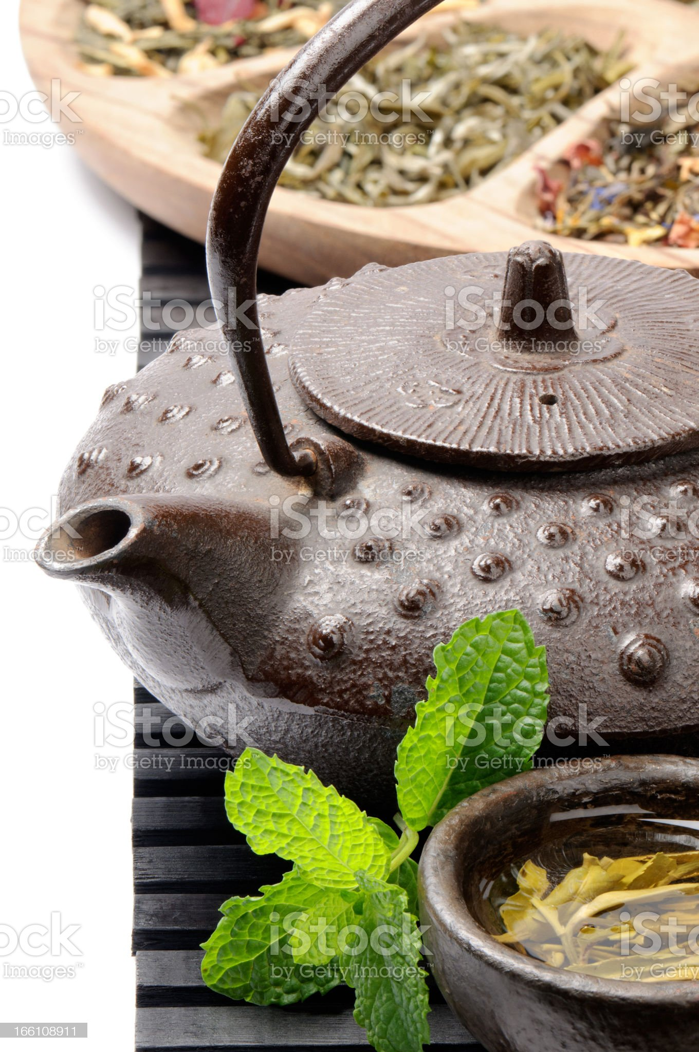 Asian teapot with green tea selection royalty-free stock photo
