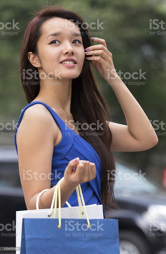 Asian Teenage Girl Holding Shopping Bag royalty-free stock photo