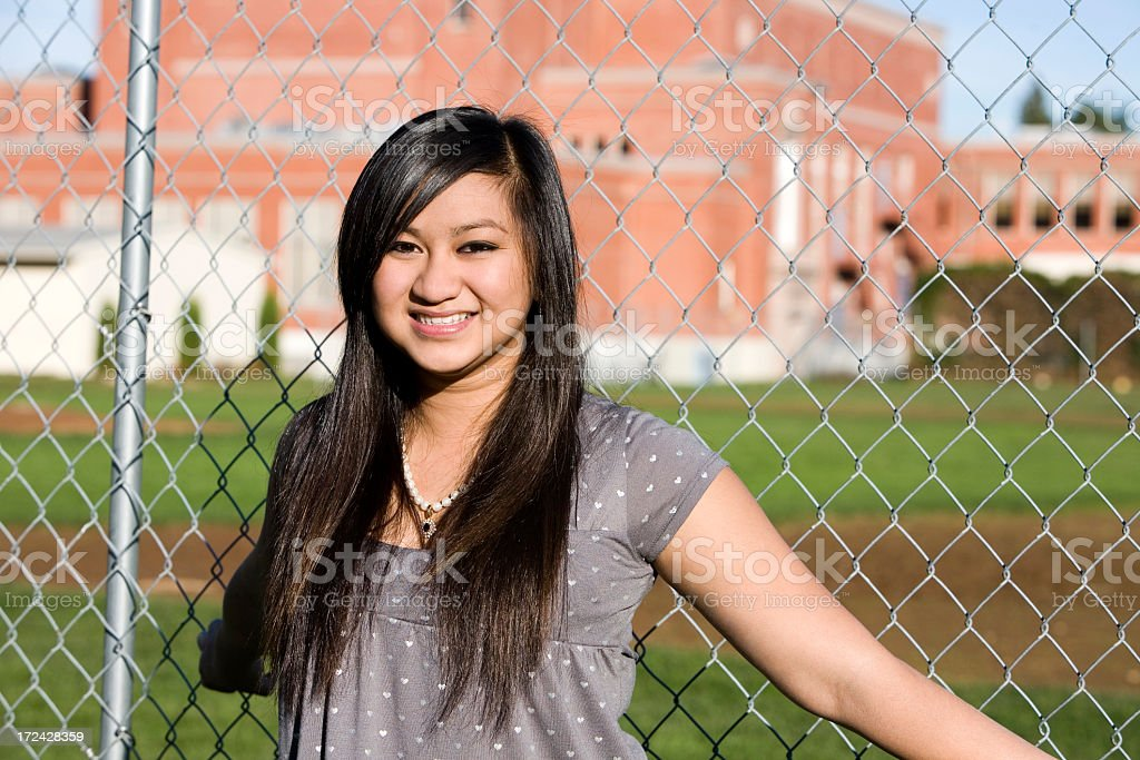 Asian Teenage Girl Smiling Outside of High School, Copy Space royalty-free stock photo