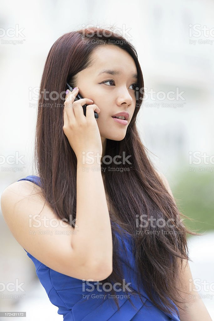 Asian Teenage Girl Talking On Cellphone royalty-free stock photo