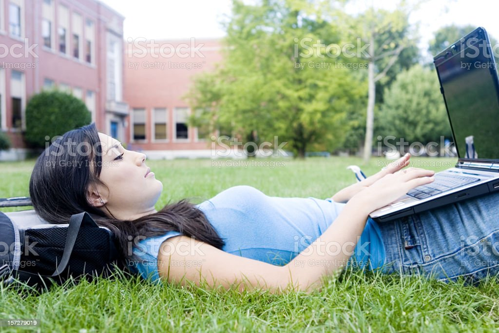 Asian Teenage Girl Using Laptop Outside High School Campus royalty-free stock photo