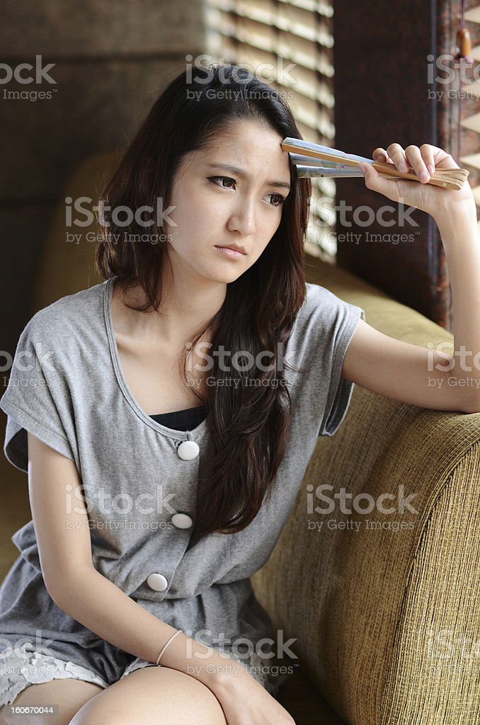 Asian teenage scowl royalty-free stock photo